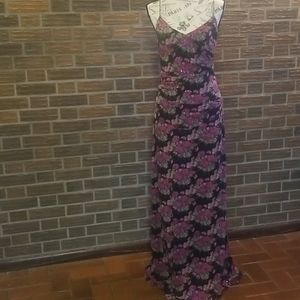 Long dress with black with rose pattern